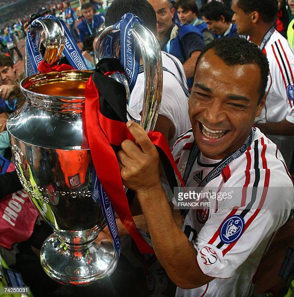 AC Milan's Brazilian defender Cafu jubilates with the trophy after winning the Champions League football final match against Liverpool at the Olympic...