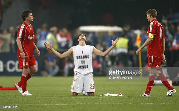 AC Milan's Brazilian midfielder Kaka celebrates in front of Liverpool's midfielder Steven Gerrard after winning the Champions League football final...