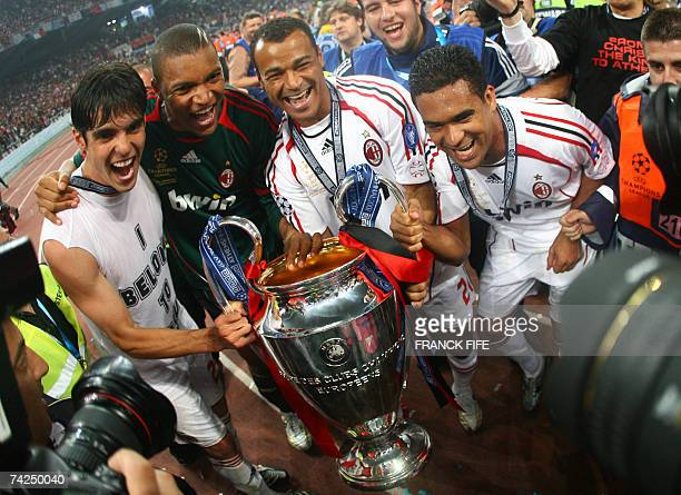 AC Milan's Brazilians players Kaka Dida Cafu and Serginho pose with the trophy after winning the Champions League football final match against...