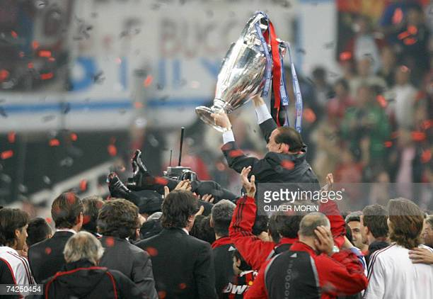 AC Milan's president Silvio Berlusconi celebrates with the trophy after winning the Champions League football match against Liverpool at the Olympic...