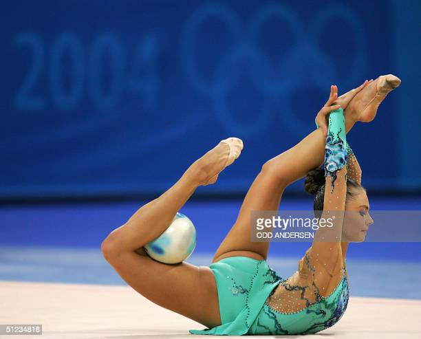 Alina Kabaeva of Russia performs with the ball during the individual allround final of the gymnastics rythmic at the Galatsi Olympic hall in Athens...