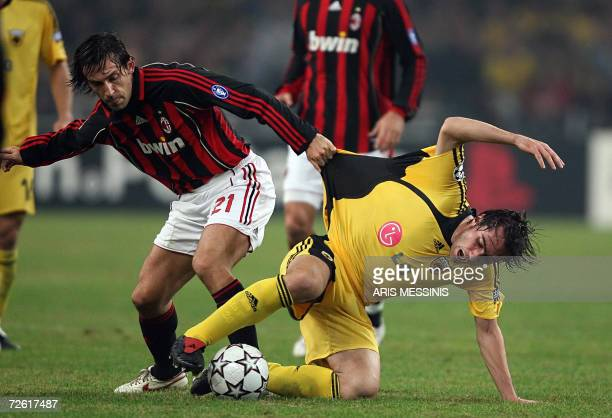 Andrea Pirlo of Milan fights for the ball with Ilias Kiriakidis of AEK during their group H Champions League football game at the Athens Olympic...