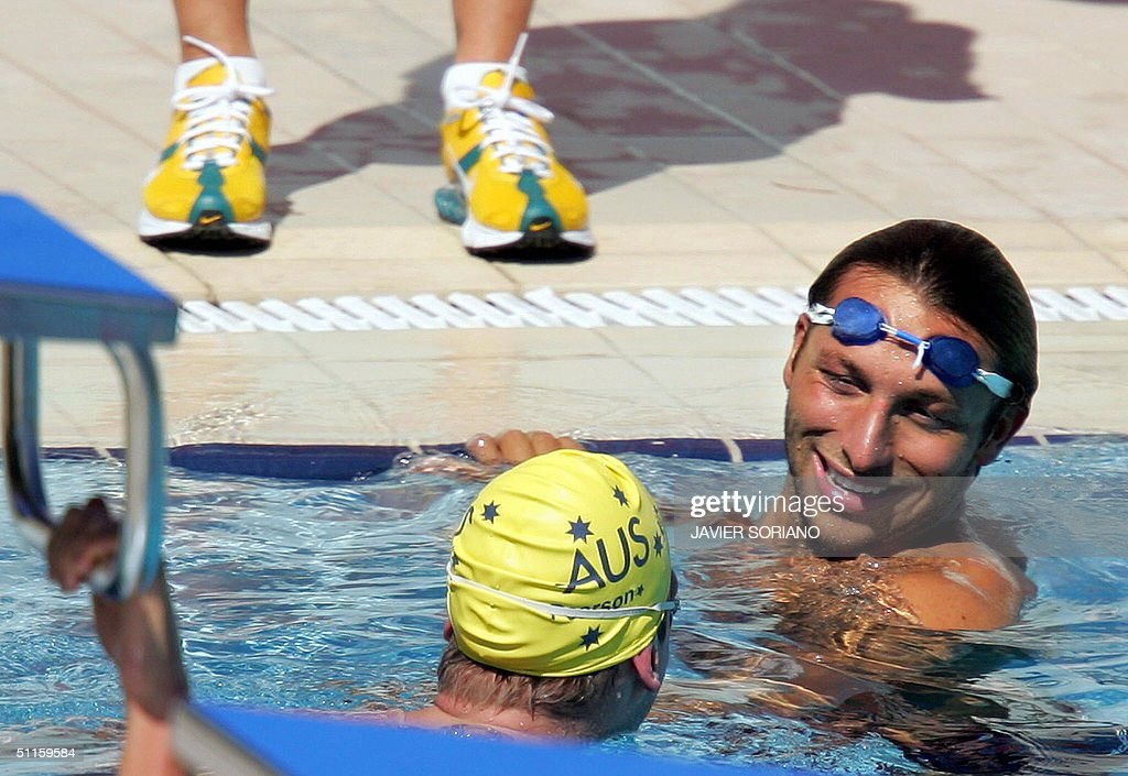 Australian swimmer Ian Thorpe jokes with a teammate during a training session at the Dekelia complex near the Olympic Village in Athens 11 August...