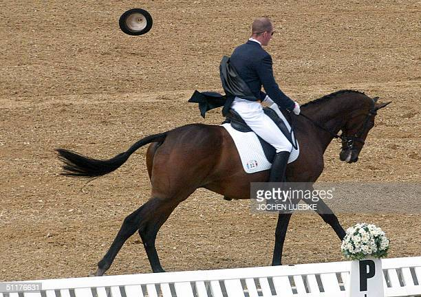Belgium's Eventing rider Dolf Desmedt riding his horse 'Bold Action' loses his hat in blustery weather 16 August 2004 at the Markopoulo Olympic...