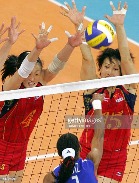 China's Liu Yanan and Wang Lina block the ball during the semifinal match in the 2004 Olympic Games volleyball tournament in Athens 26 August 2004...