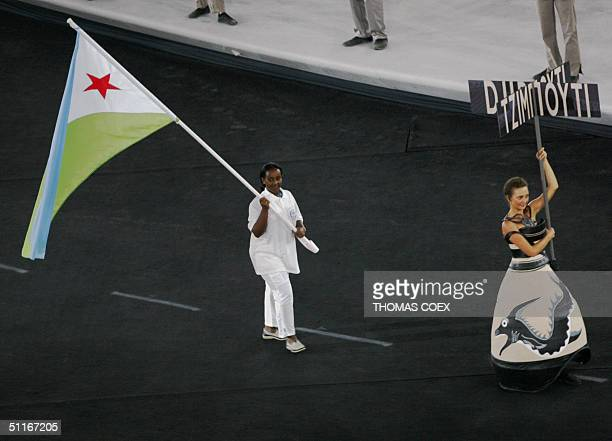 Djibouti's athlete carries the national flag during the grand opening ceremony of the XXVIII Olympiad at the Olympic Stadium in Athens 13 August 2004...