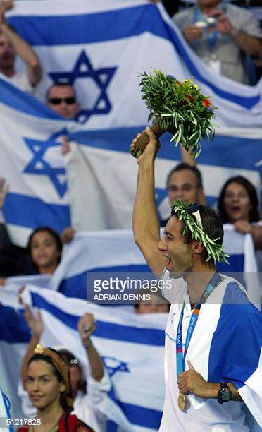 Gal Fridman of Israel is surrounded by supporters after receiving his gold medal in the Men's Windsurfer Mistral class 25 August 2004 at the 2004...