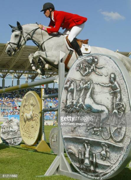 German jumping rider Christian Ahlmann jumps the medalfence on his horse 'Coster' 24 August 2004 at the Markopoulo Olympic Equestrian Centre in...