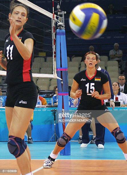 German's Angelin Angekina Grun and Christiane Furst watch the ball pass by in their game against China during the preliminary pool B match at 2004...