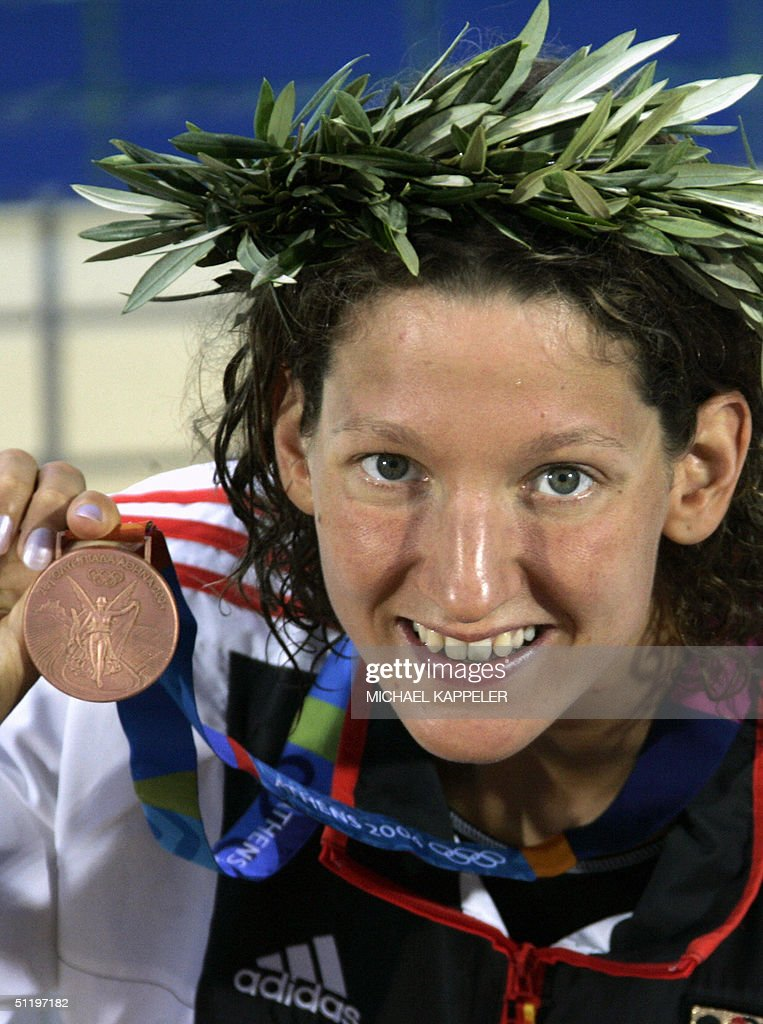 Germany's bronze medalist Antje Buschschulte presents her medal after the ...