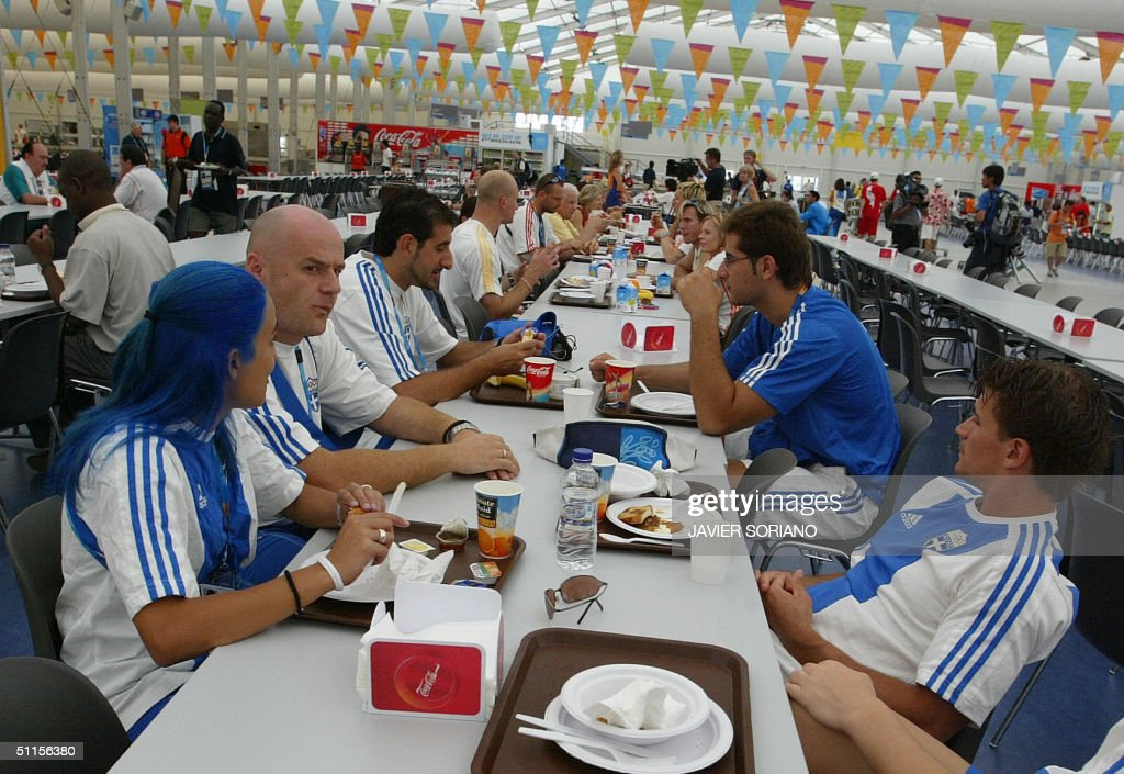 Greek athletes have lunch at the Olympic village in Athens 10 August 2004 The Olympic Games start 13 August 2004 AFP PHOTO JAVIER SORINAO
