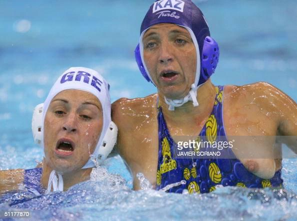Greek Stravoula Kozompli vies Tatyana Gubina during their Olympic Games women's preliminary group B match against Kazakhstan 03 at the swimming...