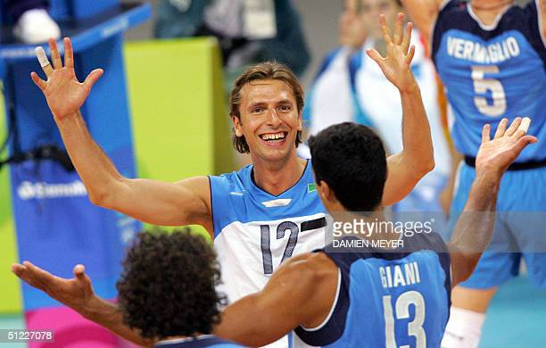 Italy's Damiano Pippi and Italy's captain Andrea Giani celebrate their victory over team Russia 30 after the semi final match in the 2004 Olympic...