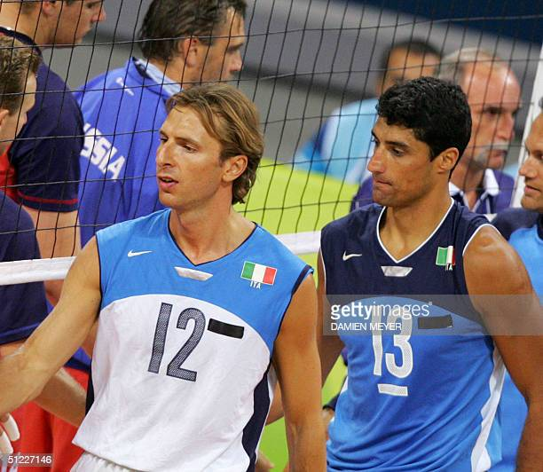 Italy's Damiano Pippi and Italy's captain Andrea Giani wear black tape on their jerseys at the Olympic Games in Athens 27 August 2004 in memory of...