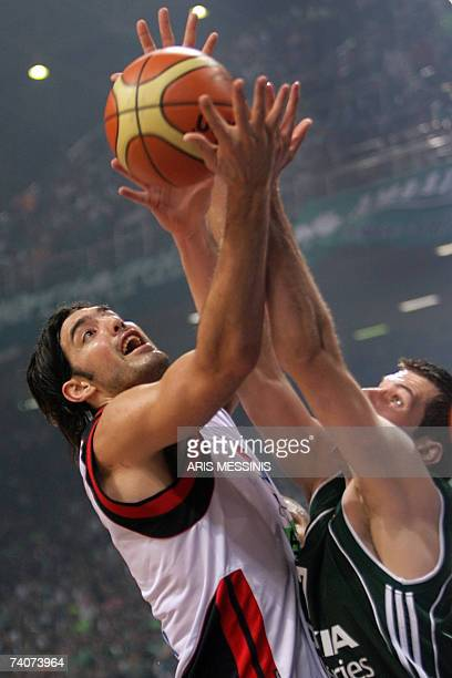 Luis Scola of Spain's Tau Ceramica is marked by Sani Becirovic of Greece's Panathinaikos during their Euroleague semifinal basketball game at the...