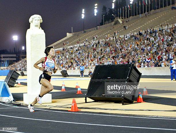 Mizuki Noguchi of Japan takes a lap into Panathinaiko Stadium on her way to winning the gold medal in the women's marathon event at the 2004 Olympic...