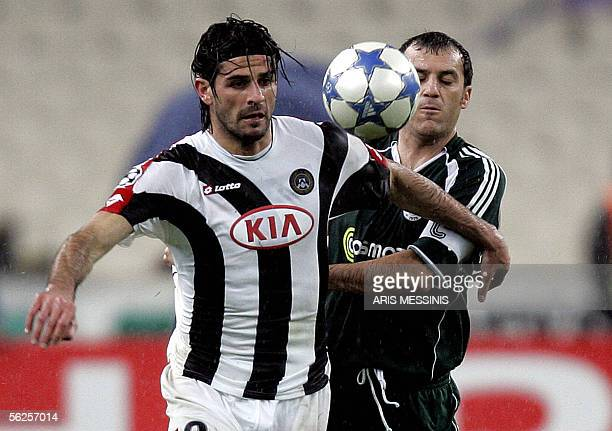 Panathinaikos' Yannis Goumas fights for the ball with Udinese's Vincenzo Iaquinta during their Group C football game for the Champions League at the...