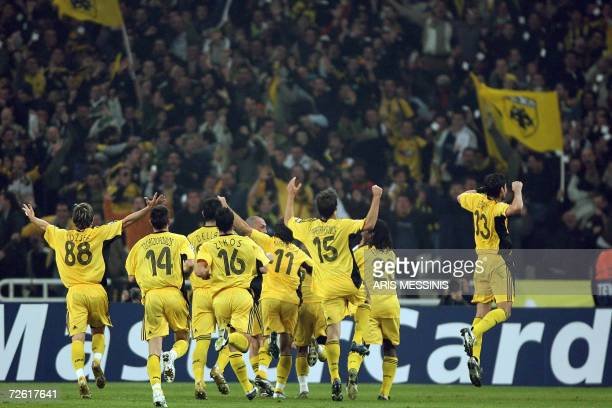 Players of AEK celebrates after a goal against Milan during their group H Champions League football game at the Athens Olympic stadium 21 November...
