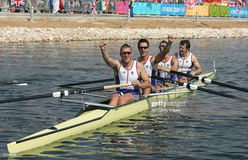 Steve Williams, James Cracknell, Ed Coode and Matthew Pinsent celebrate their win in the men's four rowing final, 21 August 2004, during the Athens 2004 Summer Olympic Games at the Schinias Olympic Rowing and Canoeing Centre in Athens. Britain's Matthew Pinsent won his fourth successive rowing gold medal in thrilling style when he led his British coxless fours to victory in a photo-finish against world champions Canada. AFP PHOTO/POOL/Shaun Botterill