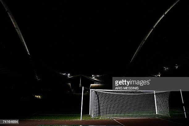 The goalposts of the Athens Olympic Stadium is highlighted after a match in this picture taken 20 October 2006 On May 23 the stadium will host the...