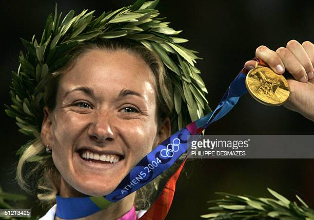 US beach volley player Kerri Walsh shows her gold medal after she and her teammate Misty May won over Brazilian Adriana Behar and Shelda Bede 24...
