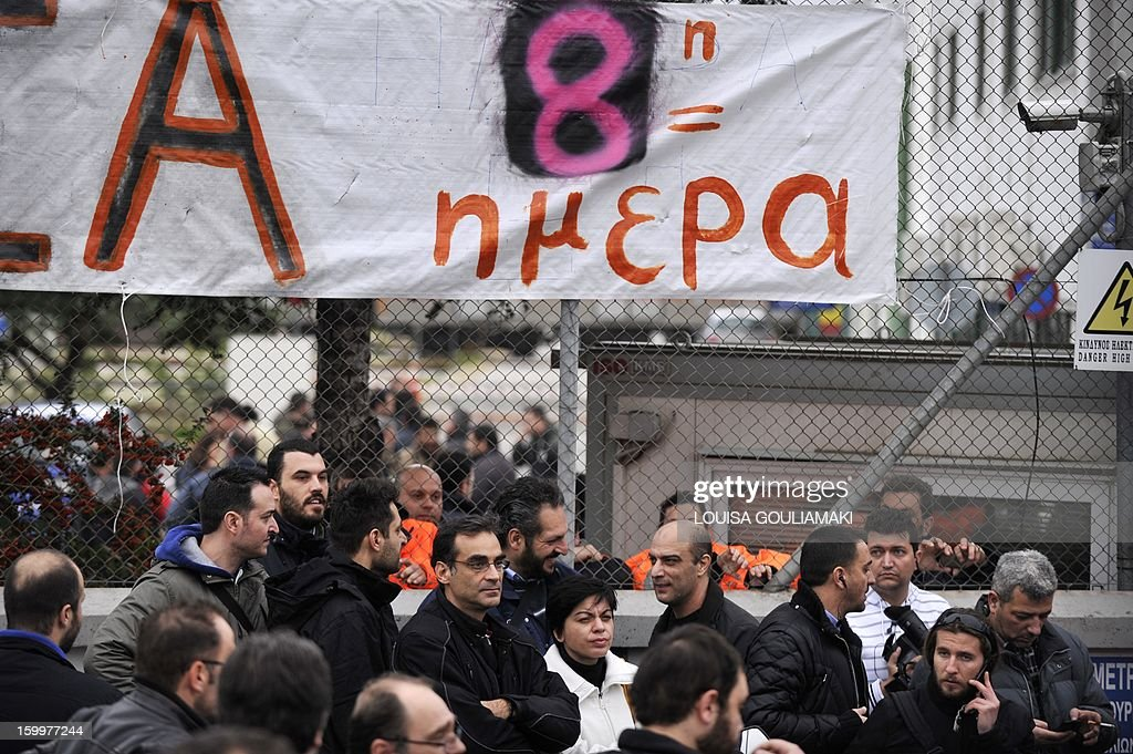 Athens metro employees on strike hold a meeting at their network's headquarters on January 24, 2013 in Athens, after Greek government ordered a civil mobilisation to break their eight-day metro standstill. The Greek government on Thursday faced internal dissent and the threat of a general transport strike after attempting to break an eight-day metro standstill.The government ordered a civil mobilisation to force the Athens metro staff to return to work, but the move was immmediately criticised by a leftist party that is part of the ruling coalition. Metro strikers reacted by barricading themselves inside the network's headquarters near Athens. Other unions from the public bus and train networks have pledged their support.Metro staff oppose government plans to reduce their pay and equate it with the broader public sector, part of reforms tied to the country's massive EU-IMF loan bailout. AFP PHOTO/ Louisa Gouliamaki