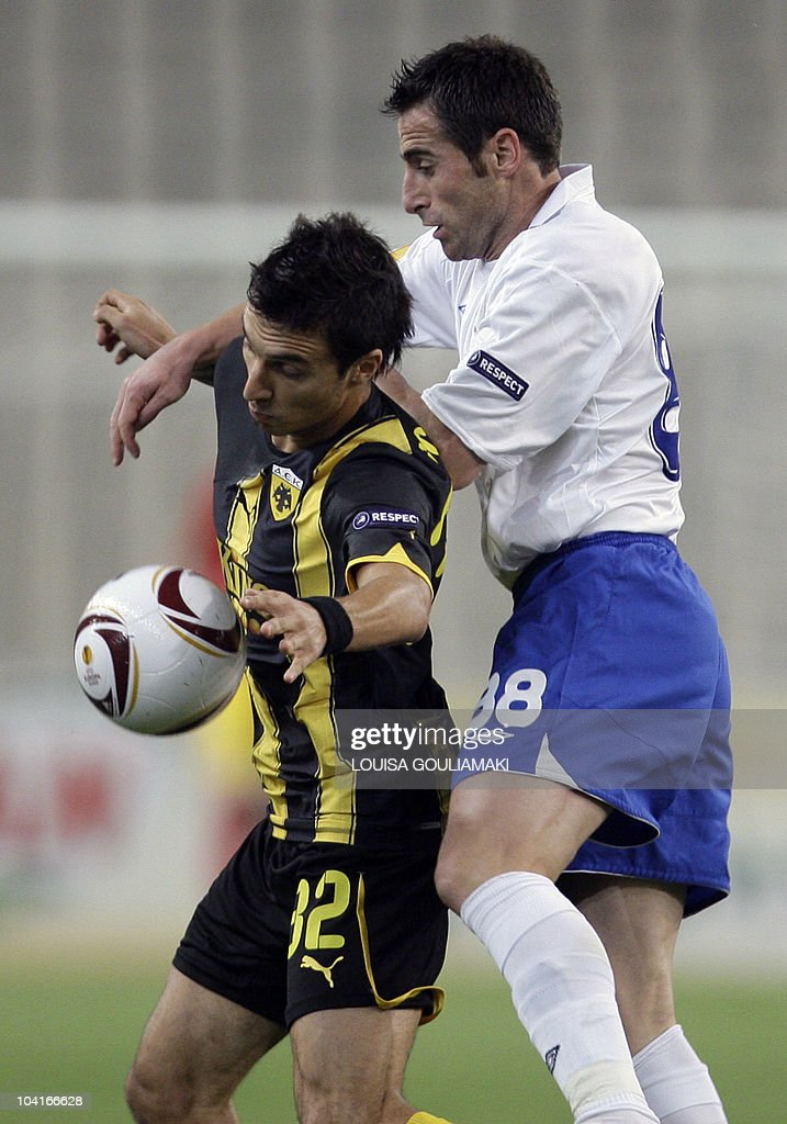 AEK Athens Nacho Scocco (L) challenges HNK Hajduk Split's Ervin Bulku during their UEFA Europa League football match at the Olympic stadium in Athens on September 16, 2010.