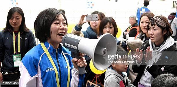 Athens Olympic Women's marathon gold medalist Mizuki Noguchi applauds fans after competing in the Nagoya Women's Marathon at the Nagoya Dome on March...