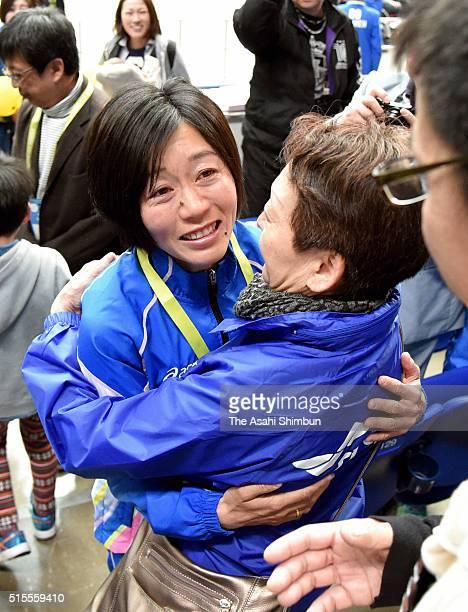 Athens Olympic Women's marathon gold medalist Mizuki Noguchi hugs with her mother after competing in the Nagoya Women's Marathon at the Nagoya Dome...