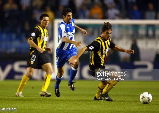 AEK Athens' Vassilios Borbokis gets away from Deportivo La Coruna's Juan Valeron