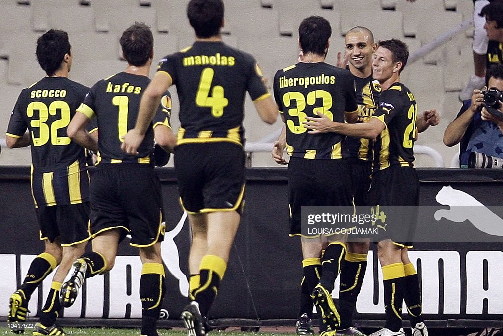 AEK Athens's Rafik Djebbour (2nd R) celebrate his goal against HNK Hajduk Split with his teammates during their UEFA Europa League football match at the Olympic stadium in Athens on September 16, 2010.