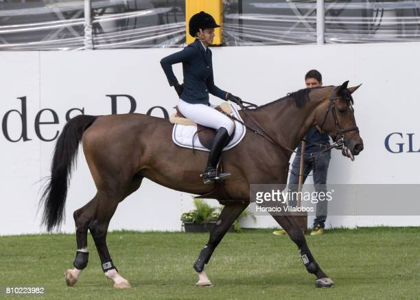 Athina Onassis of Greece reacts to a backache during Mercedes jumping competition at the first day of Longines Global Champion Tour on July 7 2017 in...