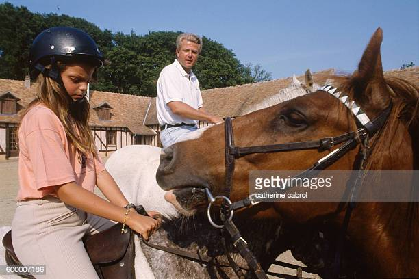 Athina Onassis Roussel granddaughter of Greek shipping magnate Aristotle Onassis riding with her father French businessman Thierry Roussel