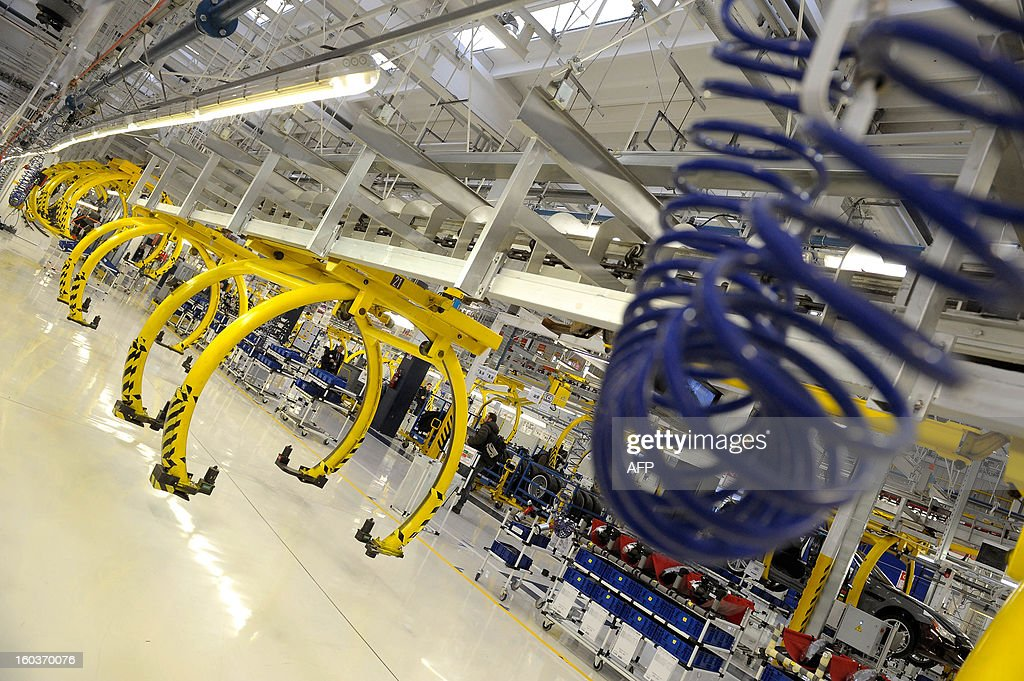 Athis picture shows a view of the assembly line during the opening of a new plant for the company's luxury brand Maserati on January 30, 2013 in Grugliasco. Italian auto giant Fiat's bosses said they had made 'difficult choices' to continue producing in Italy despite a fall in sales but would not be shutting any plants as feared earlier.