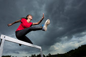 Athlete, 20 years, jumping hurdles, Winterbach, Baden-Wurttemberg, Germany
