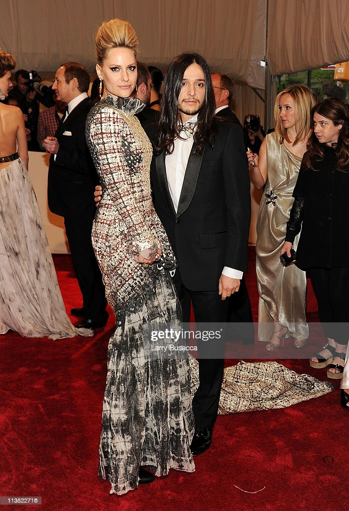 Athlete Aimee Mullins and designer Olivier Theyskens attend the 'Alexander McQueen: Savage Beauty' Costume Institute Gala at The Metropolitan Museum of Art on May 2, 2011 in New York City.