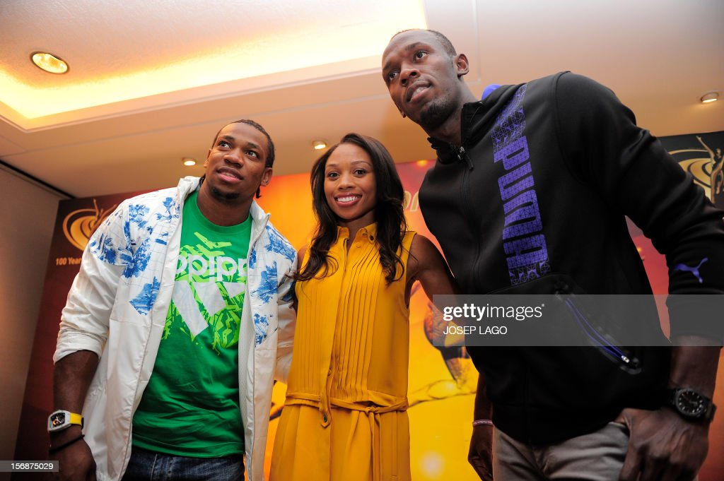 US athlete Allyson Felix (C), flanked by Jamaican athletes Yohan Blake (L) and Usain Bolt pose for photographers on November 23, 2012 in Barcelona on the eve of the IAAF (International Association of Athletics Federations) Athlete of the Year Award marking the centenay of IAAF.