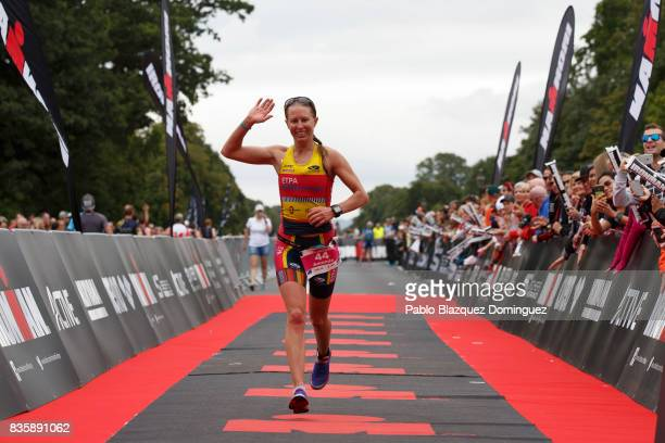 Athlete Amanda Wilson from Australia celebrates crossing the finish line in third place during the women race of IRONMAN 703 Dublin on August 20 2017...