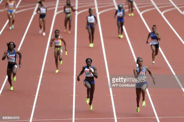 US athlete Ariana Washington finishes the anchor leg for the US team ahead of Britain's Daryll Neita and France's Carolle Zahi in the women's 4x100m...