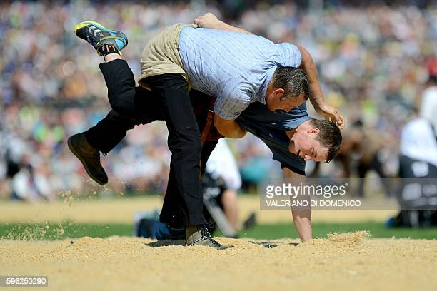 Athlete Arnold Forrer fight against Alex Schuler during the first day of the Federal Alpine Wrestling Festival on August 27 2016 in Payerne western...