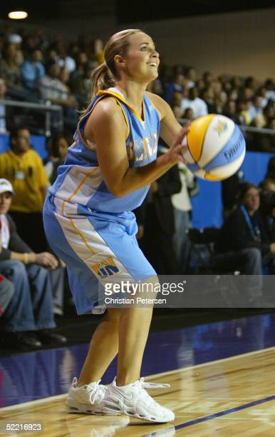 WNBA athlete Becky Hammon of Team Denver shoots a 3 point shot during the McDonald's NBA AllStar Celebrity Game at the Colorado Convention Center on...