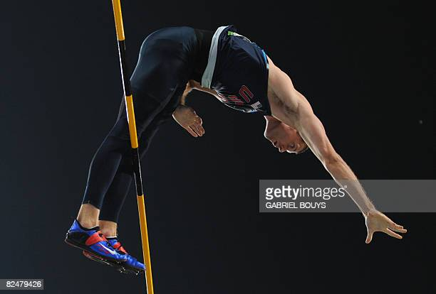 US athlete Brad Walker competes during the men's Pole vault qualifiers at the National stadium as part of the 2008 Beijing Olympic Games on August 20...