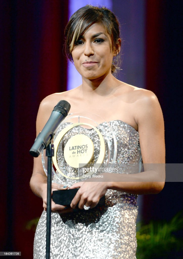 Athlete Brenda Martinez accepts the award for Special Achievement in Sports onstage at the '2013 Latinos de Hoy Awards' Sponsored by OneLegacy on Saturday, October 12 at Los Angeles Times Chandler Auditorium in Los Angeles, California.