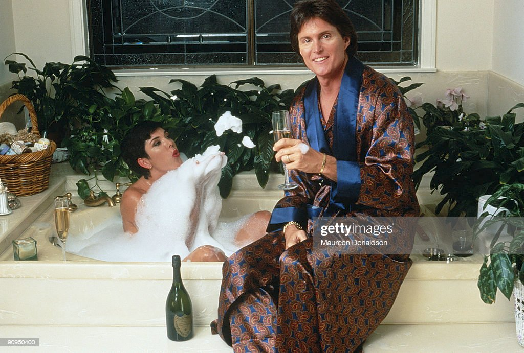 US athlete Bruce Jenner and his partner Kris Jenner formerly Kris Kardashian share a bottle of Dom Perignon over a bubble bath circa 1991