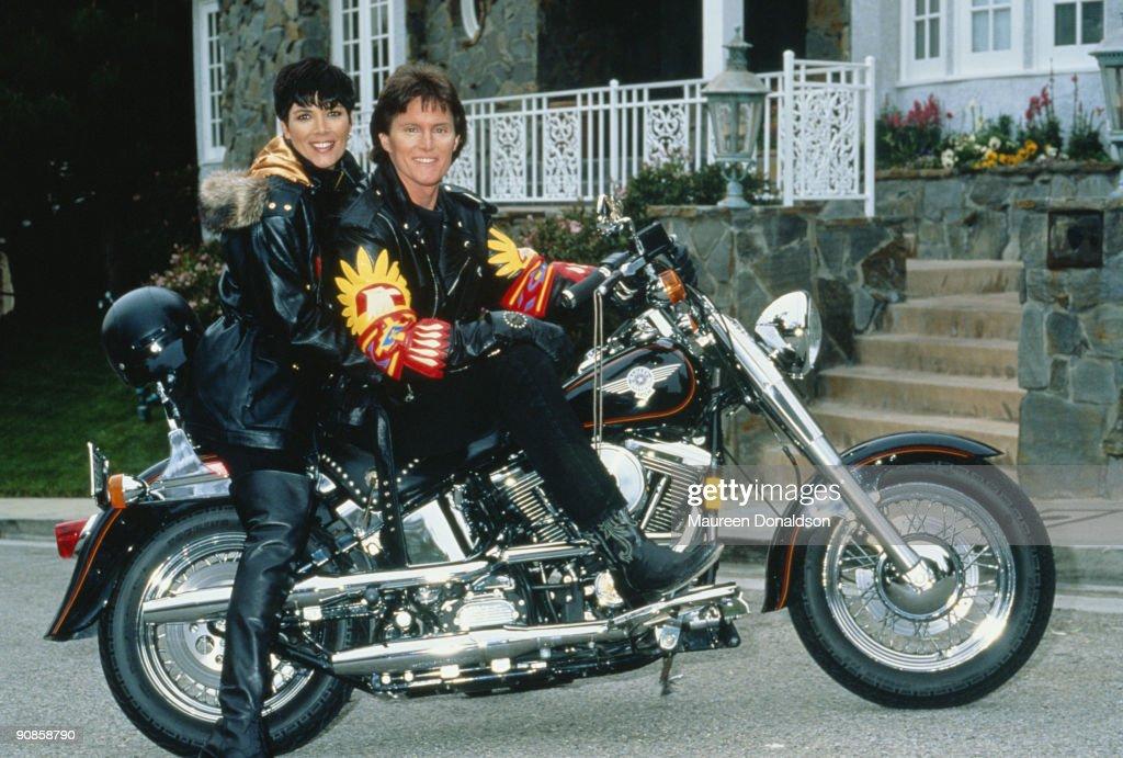 US athlete Bruce Jenner poses on a HarleyDavidson with his partner Kris Jenner formerly Kris Kardashian circa 1991