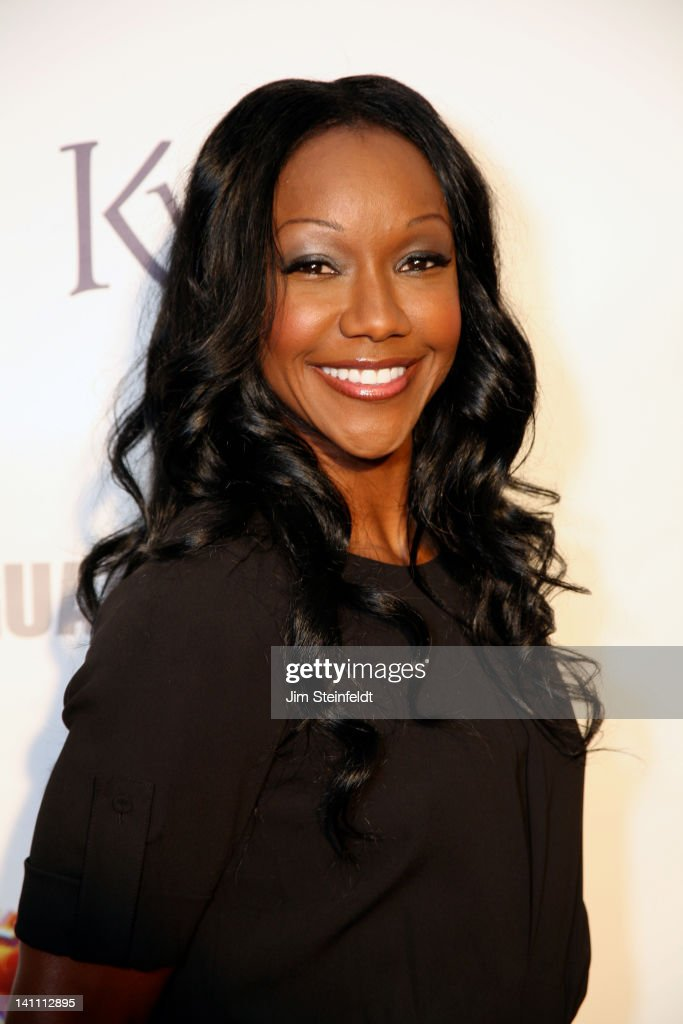 Athlete <a gi-track='captionPersonalityLinkClicked' href=/galleries/search?phrase=Carmelita+Jeter&family=editorial&specificpeople=4472760 ng-click='$event.stopPropagation()'>Carmelita Jeter</a> poses on the red carpet at The Guard A Heart tribute to Larry King at the Avalon Ballroom in Hollywood, California on February 25, 2012.