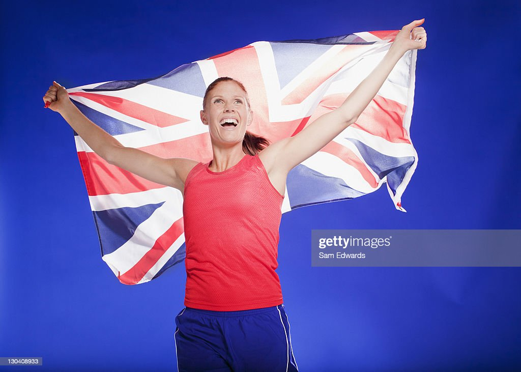 Athlete carrying Union Jack flag : Stock Photo