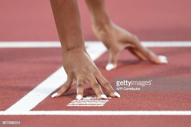 US athlete Cassandra Tate at the start during the heats of the women's 400m hurdles athletics event at the 2017 IAAF World Championships at the...