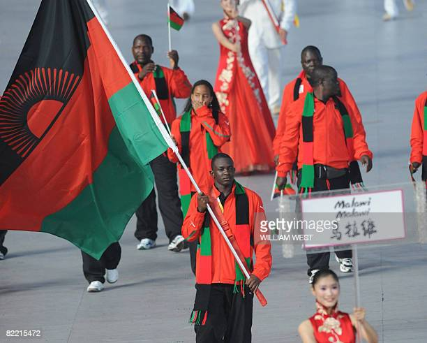 Athlete Charlton Nyirenda Malawi's flag bearer parades in front of his delegation during the 2008 Beijing Olympic Games opening ceremony on August 8...
