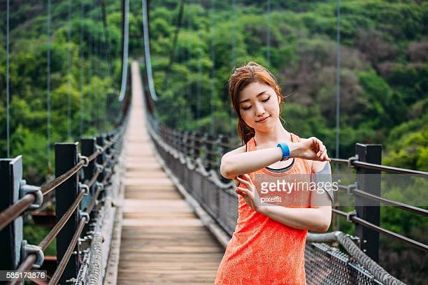 Athlete checking her smart watch